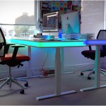 The TableAir standing desk rises with a wave of the hand